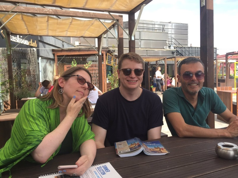 Image: Thorunn Helgason, William Rimington and Martin Bidartondo enjoying the rooftop terrace view of Prague. Credit: Katie Field.