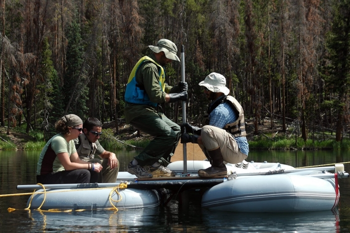 Dunnette, Higuera, and National Park employees collect samples from Chickaree Lake, Colorado, USA. Photo: Grace Carter